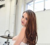 Emelia Paige teasing in white bodysuit by the drum set 3