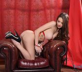 Emelia Paige teasing in the chair in sexy red lingerie 7