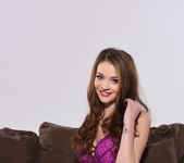 Emelia Paige teasing on the sofa in purple lingerie showing 2