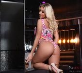 Stacey Robyn strips out of her colorful Barbie bodysuit 4