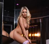 Stacey Robyn strips out of her colorful Barbie bodysuit 14