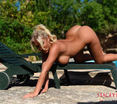 Stacey Robyn strips by the pool 15