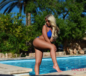 Stacey Robyn strips nude by the pool in her blue bikini 2