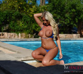 Stacey Robyn strips nude by the pool in her blue bikini 9