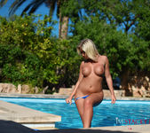 Stacey Robyn strips nude by the pool in her blue bikini 12