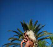 Stacey Robyn strips nude by the pool in her blue bikini 16