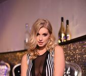 Jess Davies teases in her black and white striped body suit 2