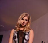 Jess Davies teases in her black and white striped body suit 3