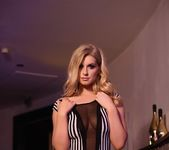 Jess Davies teases in her black and white striped body suit 7