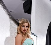 Jess Davies teases on the white sofa, in her lingerie 5