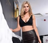 Jess Davies teasing in her black leather skirt and top 2