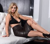 Jess Davies teasing in her black leather skirt and top 6