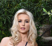 Jess Davies teasing in the garden in blue bodysuit 12
