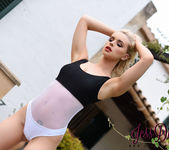Jess Davies teasing in her black and white bodysuit outdoors 4