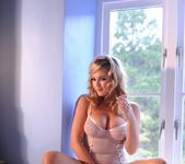 Jodie teases in her white see through bodysuit 6