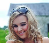 Jodie Gasson strips outdoors from her secret agent attire 16