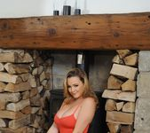 Jodie Gasson teases next to the fire pit in her red bodysuit 3