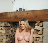 Jodie Gasson teases next to the fire pit in her red bodysuit 16