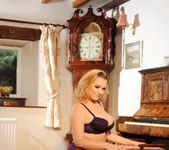 Jodie Gasson teasing in her dark purple lingerie 2