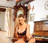 Jodie Gasson teasing in her dark purple lingerie 4