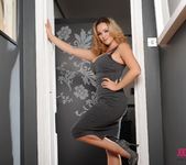 Jodie Gasson teasing in her long grey dress in the doorway 4
