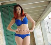 Lucy V teases on the patio in her blue lingerie 8