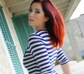 Lucy V teases in her blue and white stripped body suit 4