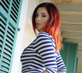 Lucy V teases in her blue and white stripped body suit 6