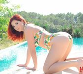 Lucy V teases in her cute floral print bathing suit 5
