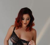 Lucy V teases in her black body suit and stockings 9