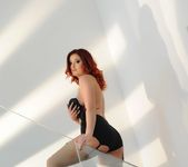 Lucy teases in her black top and panties on the stairs 8