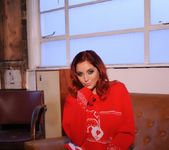 Lucy V teases on the sofa, while in her red Xmas sweater 2