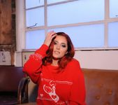 Lucy V teases on the sofa, while in her red Xmas sweater 3