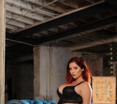 Lucy V seduces us on the blue chair, in her black bodysuit 3