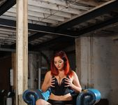 Lucy V seduces us on the blue chair, in her black bodysuit 7