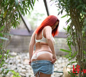 Lucy V teasing in the garden in her blue jean cutoffs 4
