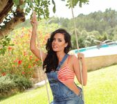 Ann Denise teases on the swing in her overalls and panties 2