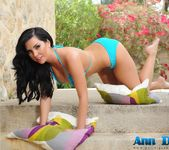 Ann Denise teases in her blue bikini outdoors 3
