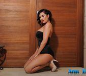 Ann teases in her black bodysuit and white heels 7