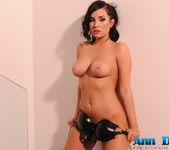 Ann Denise in her black leather bodysuit on the staircase 16