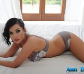 Ann Denise teasing in her grey lingerie on the bed 3