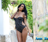 Ann Denise teasing outdoors in her bodysuit on the steps 6