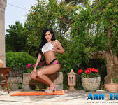 Ann Denise teasing outdoors on the patio 3