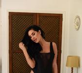 Ann Denise teasing on the bed in black bodysuit 2