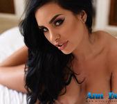 Ann Denise teasing on the bed in black bodysuit 16
