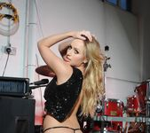 Holly Gibbons in black lingerie at the drum set 8