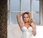 Holly Gibbons in white corset and black stockings 3