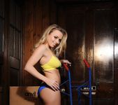 Holly Gibbons in yellow top and blue panties on loading dock 2