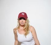 Holly teases in her Yankees cap and white top 6