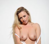 Holly teases in her Yankees cap and white top 10